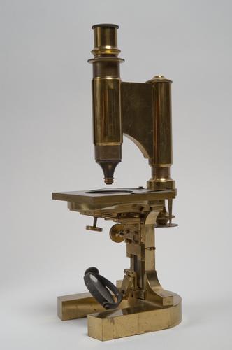 Samengesteld achromatisch microscoop op hoefijzerstatief
